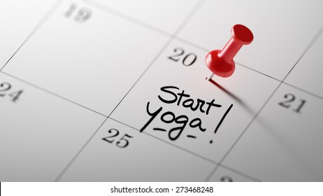 Concept image of a Calendar with a red push pin. Closeup shot of a thumbtack attached. The words Start Yoga written on a white notebook to remind you an important appointment.