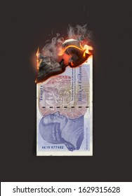 A concept image showing a half burnt flat british pound paper note still on fire on a dark studio background - 3D render