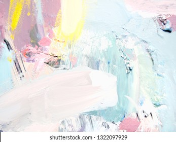 The concept of modern art. Blurred abstract background. Palette with paint close-up. Background of delicate pastel tones.