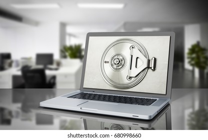 The concept of a secure online banking Money and cards behind the open door of the bank vault on the monitor screen 3d render on grey