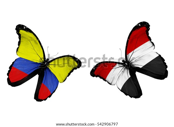 Concept - two butterflies with Colombia and Yemen  flags flying