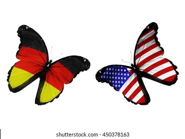 Concept - two butterflies with Germany and USA  flags flying