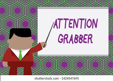 Conceptual hand writing showing Attention Grabber. Business photo showcasing Deanalysisding notice mainly by being prominent or outlandish Businessman standing in projector pointing project idea.