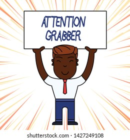 Conceptual hand writing showing Attention Grabber. Business photo showcasing Deanalysisding notice mainly by being prominent or outlandish Smily Man Standing Holding Placard Overhead with Both Hands.