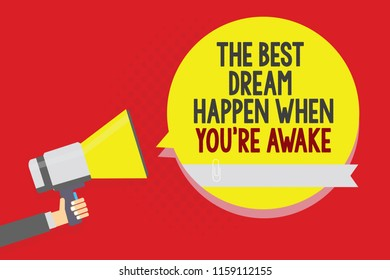 Conceptual hand writing showing The Best Dream Happen When You re are Awake. Business photo text Dreams come true Have to believe Man holding megaphone loudspeaker yellow bubble on red background.