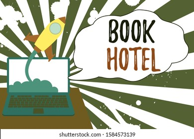 Conceptual hand writing showing Book Hotel. Business photo showcasing an arrangement you make to have a hotel room or accommodation Successful rocket launching laptop background Startup grow.