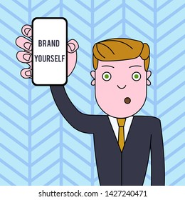 Conceptual hand writing showing Brand Yourself. Business photo text Develop a unique professional identity Personal product Man Holding Vertical Smartphone Device Screen for Attention.