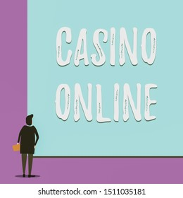 Conceptual hand writing showing Casino Online. Business photo showcasing Computer Poker Game Gamble Royal Bet Lotto High Stakes Back view young woman watching blank big rectangle.