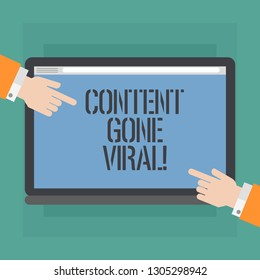 Conceptual hand writing showing Content Gone Viral. Business photo showcasing image video link that spreads rapidly through population Hu analysis Hands Pointing on a Blank Color Tablet Screen.