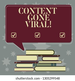 Conceptual hand writing showing Content Gone Viral. Business photo showcasing image video link that spreads rapidly through population Uneven Pile of Hardbound Books and Rectangular Speech Bubble.
