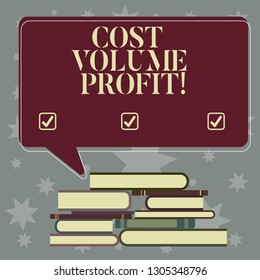 Conceptual hand writing showing Cost Volume Profit. Business photo showcasing form of cost accounting and It is simplified model Uneven Pile of Hardbound Books and Rectangular Speech Bubble.