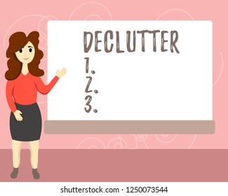 Conceptual hand writing showing Declutter. Business photo text remove unnecessary items from untidy or overcrowded place Female Hu analysis Presenting Rectangular Blank Whiteboard.