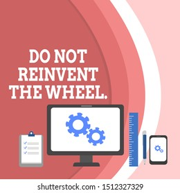 Conceptual hand writing showing Do Not Reinvent The Wheel. Business photo text stop duplicating a basic method previously done Business Concept PC Monitor Mobile Device Clipboard Ruler.