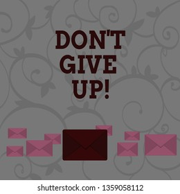 Conceptual hand writing showing Don T Give Up. Business photo showcasing you should continue doing what you are good at Resist Color Envelopes in Different Sizes with Big one in Middle.