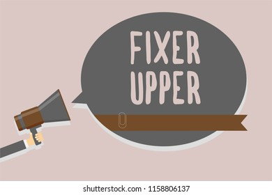 Conceptual hand writing showing Fixer Upper. Business photo text house in need of repairs used chiefly connection with purchase Man holding megaphone loudspeaker speech bubble message speaking.