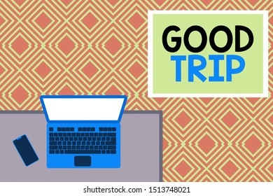 Conceptual hand writing showing Good Trip. Business photo text A journey or voyage,run by boat,train,bus,or any kind of vehicle Office working place laptop lying wooden desk smartphone.