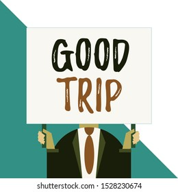 Conceptual hand writing showing Good Trip. Business photo showcasing A journey or voyage,run by boat,train,bus,or any kind of vehicle Man chest dressed dark suit tie face holding big rectangle.
