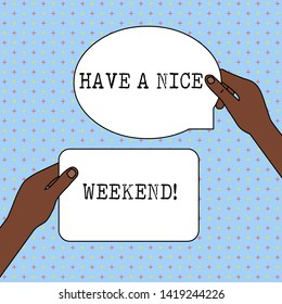 Conceptual hand writing showing Have A Nice Weekend. Business photo text wishing someone that something nice happen holiday Two Figured Tablets Signs Held in Hands One Above Other Text Space.