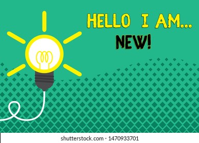 Conceptual hand writing showing Hello I Am New. Business photo showcasing used as greeting or to begin telephone conversation Idea light bulb Successful turning idea invention Startup.