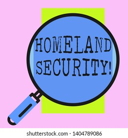 Conceptual hand writing showing Homeland Security. Business photo showcasing federal agency designed to protect the USA against threats Round magnifying glass with iron handle frame to look bigger.