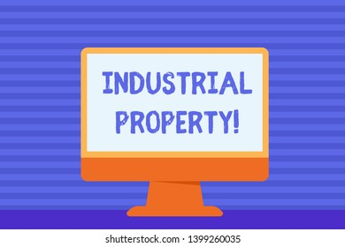 Conceptual hand writing showing Industrial Property. Business photo showcasing the intangible ownership of a trademark or patent Blank Desktop Computer Colorful Screen Freestanding on Table.