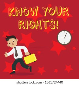 Conceptual hand writing showing Know Your Rights. Business photo showcasing must have knowledge about what you owe to community Man Carrying Briefcase Walking Past the Analog Wall Clock.