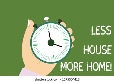 Conceptual hand writing showing Less House More Home. Business photo showcasing Have a warm comfortable place to live with family love Hu analysis Hand Holding Stop Watch Timer Start Stop Button.