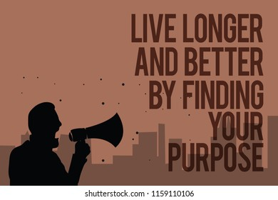 Conceptual hand writing showing Live Longer And Better By Finding Your Purpose. Business photo text Look for a goal set mission Man holding megaphone politician making promises brown background.