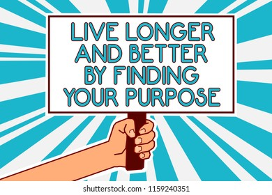 Conceptual hand writing showing Live Longer And Better By Finding Your Purpose. Business photo text Look for a goal set mission Man hand holding poster important protest message blue background.