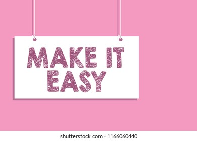 Conceptual hand writing showing Make It Easy. Business photo text Smart approach Effortless Free from worries or difficulties Hang board communicate information open close sign pink background.