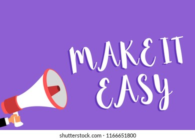 Conceptual hand writing showing Make It Easy. Business photo text Smart approach Effortless Free from worries or difficulties Man holding megaphone loudspeaker purple background speaking loud.