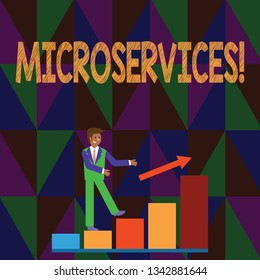 Conceptual hand writing showing Microservices. Business photo text Software development technique Decomposing an application Smiling Businessman Climbing Bar Chart Following an Arrow Up.