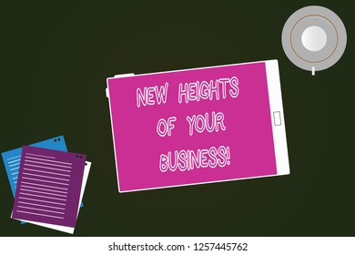 Conceptual hand writing showing New Heights Of Your Business. Business photo text Achieving goals fast growing up company Tablet Screen Cup Saucer and Filler Sheets on Color Background.