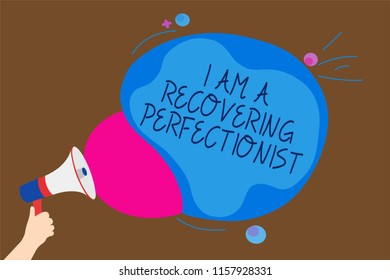 Conceptual hand writing showing I Am A Recovering Perfectionist. Business photo text Obsessive compulsive disorder recovery Man holding Megaphone loudspeaker screaming talk speech bubble.
