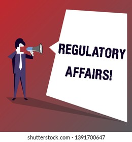Conceptual hand writing showing Regulatory Affairs. Business photo showcasing the desire of governments to protect public health Businessman Shouting on Megaphone and White Speech Bubble.