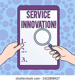 Conceptual hand writing showing Service Innovation. Business photo showcasing Improved Product Line Services Introduce upcoming trend Hands Holding Magnifying Glass Against Switched Off Tablet.