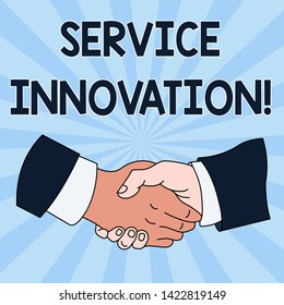 Conceptual hand writing showing Service Innovation. Business photo showcasing Improved Product Line Services Introduce upcoming trend Hand Shake Multiracial Male Colleagues Formal Shirt Suit.