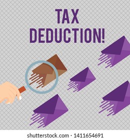 Conceptual hand writing showing Tax Deduction. Business photo showcasing amount subtracted from income before calculating tax owe Magnifying Glass on Color Envelope and others has Same Shade.