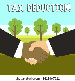 Conceptual hand writing showing Tax Deduction. Business photo showcasing amount subtracted from income before calculating tax owe Hand Shake Multiracial Male Business Partners Formal Suits.