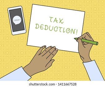 Conceptual hand writing showing Tax Deduction. Business photo text amount subtracted from income before calculating tax owe Top View Man Writing Paper Pen Smartphone Message Icon.