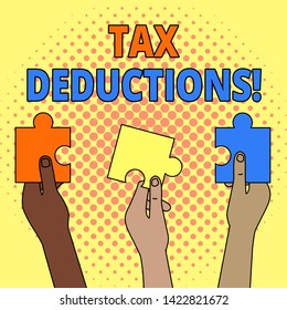 Conceptual hand writing showing Tax Deductions. Business photo showcasing reduction income that is able to be taxed of expenses Three Colored Jigsaw Puzzle Pieces in Different People Hands.