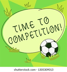 Conceptual hand writing showing Time To Competition. Business photo showcasing resource and firm that make better use of minutes Soccer Ball on the Grass and Blank Round Color Shape photo.