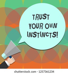 Conceptual hand writing showing Trust Your Own Instincts. Business photo text Intuitive follow demonstratingal feelings confidence Hu analysis Hand Holding Megaphone Color Speech Bubble.