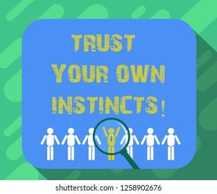 Conceptual hand writing showing Trust Your Own Instincts. Business photo text Intuitive follow demonstratingal feelings confidence Magnifying Glass Over Chosen Man Hu analysis Dummies Line Up.