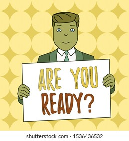 Conceptual hand writing showing Are You Ready Question. Business photo text Setting oneself on the activity Being Prepared Smiling Man Holding Suit Poster Board in Front of Himself.