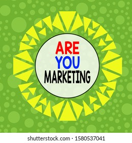 Conceptual hand writing showing Are You Marketing. Business photo showcasing Actions to promote brand product Sales in market Asymmetrical uneven shaped pattern object multicolour design.