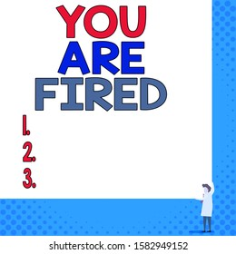 Conceptual hand writing showing You Are Fired. Business photo showcasing Getting out from the job and become jobless not end the career Young woman holding two hands right corner blank rectangle.