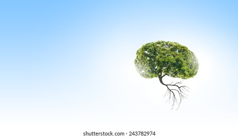 Conceptual image of green tree shaped like brain