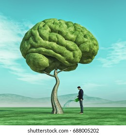 Conceptual image of a man squirting a big tree shaped human brain on a green field. 