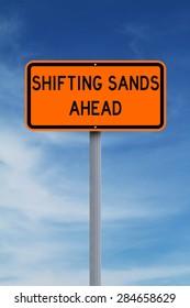 Conceptual road sign warning of shifting sands ahead
